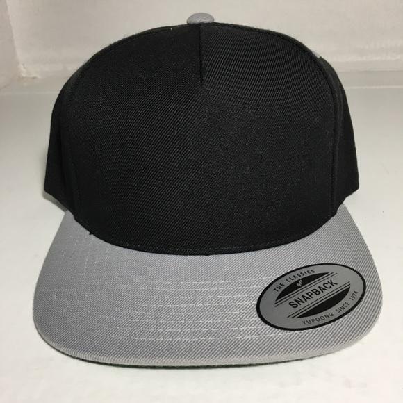 3970c5afd72e6 ... Classics SnapBack Hat Black Gray. NWT. Yupoong.  M 5ca9093a152812567a533645. M 5ca9093c1153ba9e6018e8b1.  M 5ca9093e7a817377b0551732